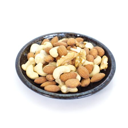 Various mixed nuts isolated on white background