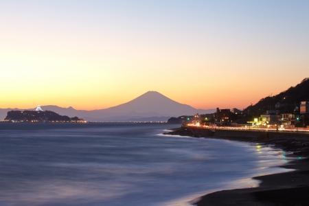 enoshima: Beach and waves, Mt Fuji and Enoshima Island.  Stock Photo