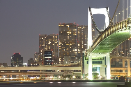 japan sunset: View of Tokyo cityscape at night with Rainbow Bridge