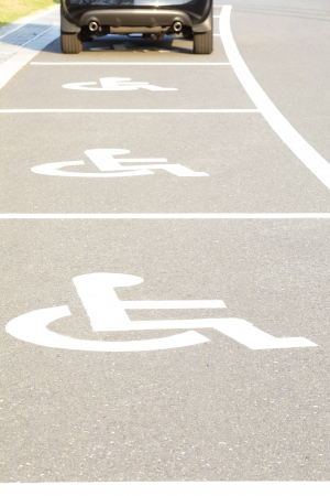 pictorial  representation: Several handicap parking areas reserved for disabled people