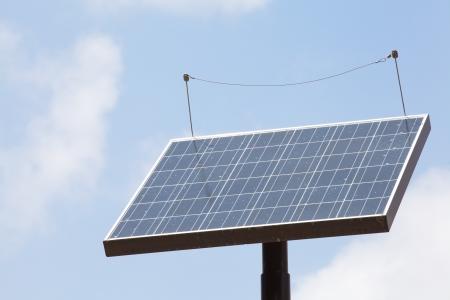 Solar panel against blue sky  photo