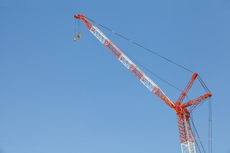 Construction site with crane over a building photo