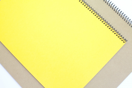 yellow note book isolate on white background