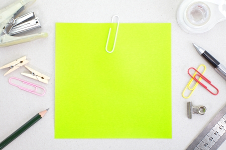 instigator: Colored papers with staple and stationery  Stock Photo