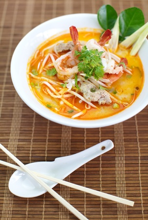 Thai Dishes, Tom Yam Koong soup with noodles photo
