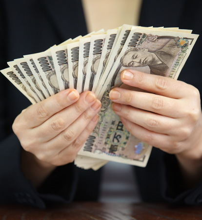 japanese currency: Hand counting money, Japanese currency note , Japanese yen