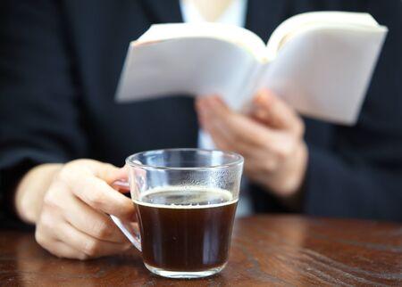 Close up of female holding mug with hot coffee