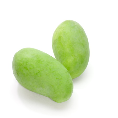 Green mango isolated on a white  photo