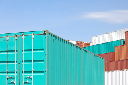 cargo containers in storage area of freight sea port terminal  photo