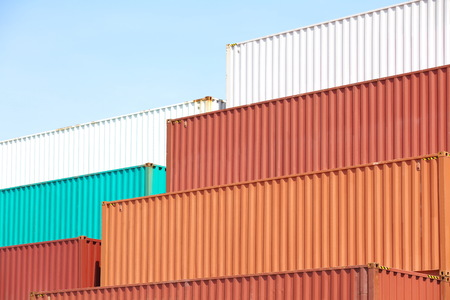 Stacked cargo containers in storage area of freight sea port terminal  photo