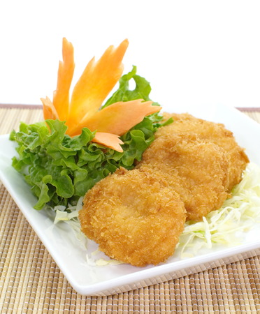 fried shrimp cake with green vegetables photo