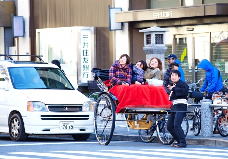 Tourists rides a rickshaw at Sensoji Asakusa Kannon Temple