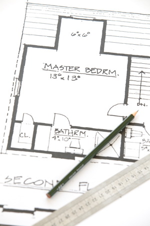 Architect rolls and plans architectural plan  Stock Photo