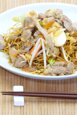 Chinese style deep fried yellow noodles with pork photo