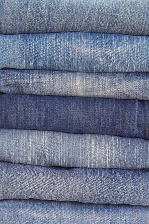 bluejeans: Lot of different blue jeans close-up Stock Photo
