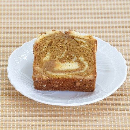 mocca: Sponge cake mocca on bamboo plate background