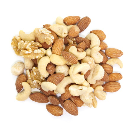 Mix of nuts close - up on white background photo