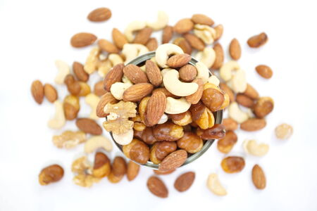 Mix of nuts close - up on white background