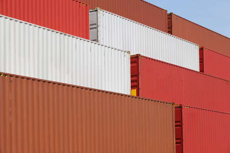 Stacked cargo containers in freight sea port terminal photo