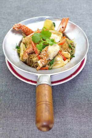 fried Crab and grass noodles served on the pan photo