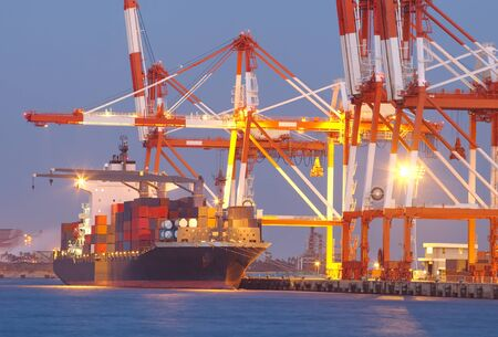 Container Cargo freight ship with working crane bridge in shipyard photo