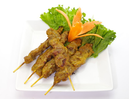 Grilled Pork Satay with fresh vegetable on white background photo