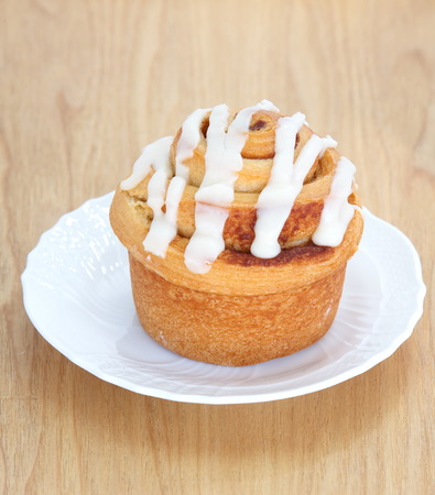 cinammon: Delicious Cinnamon roll on wood tray background