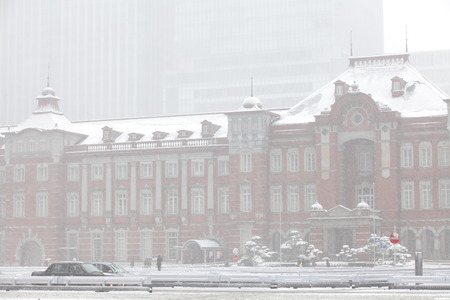 Tokyo station in heavy snow on winter 2014 photo