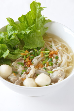 pork clear noodle soup with fish ball and vegetable photo