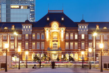 tokyo train station building light up at twilight