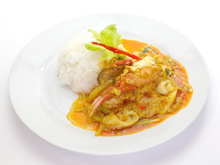 stir - fried crab with curry powder and white rice photo