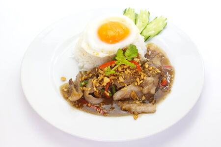 fried sliced pork with garlic and fried egg photo