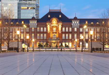 tokyo train station building light up at twilight photo