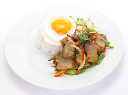 Basil fried rice with pork in white dish photo