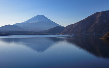 Mountain fuji in winter season from lake motosu photo