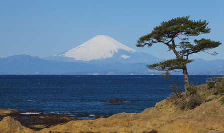 Mountain fuji and the ocean from sagami bay , yokosuka japan photo