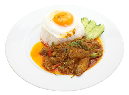 savory curry pork and white rice with egg on top photo