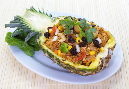 baked rice pineapple and vegetables served in pineapple