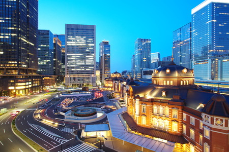 view of tokyo station and marunoichi business area in tokyo photo