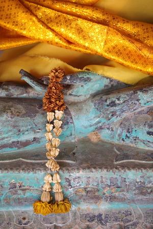 Buddha hand and long yellow garland photo