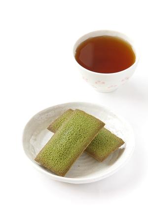 maccha: maccha green tea financier cake and cup of tea