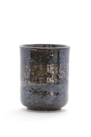 Japanese traditional black ceramic tea cup on white  photo