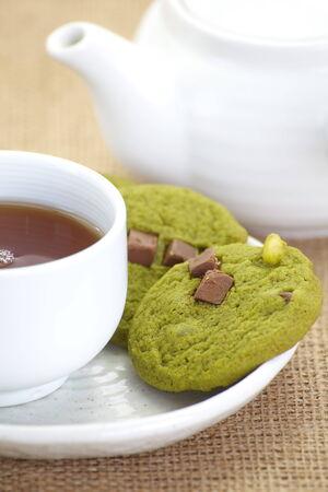 maccha: Japanese Maccha green tea cookie and cup of tea Stock Photo