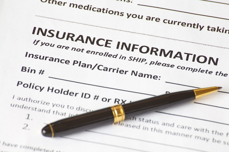Close - up insurance information with a pen photo