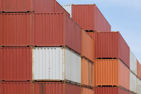 Stack of colorful cargo containers at container yard photo