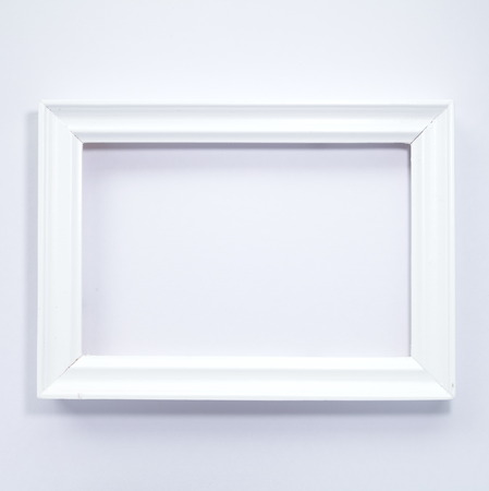 White wooden photo frame on white background Zdjęcie Seryjne