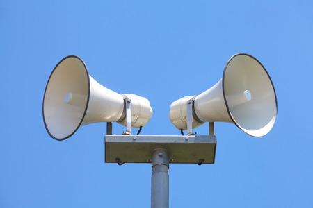 convey: Outside loudspeaker against nice blue sky