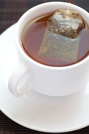 A Cup of tea with pyramid teabag  photo