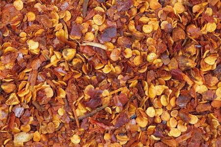crushed red peppers: close - up dried and crushed red peppers Stock Photo