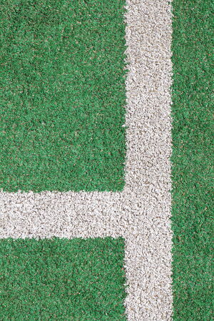 artifical: green artifical grass and white strip line